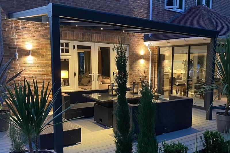 Outdoor seating area with veranda and lights